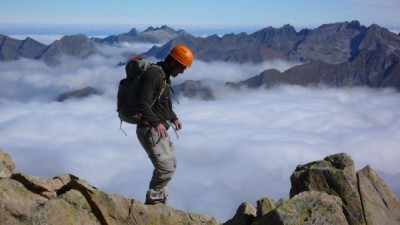 Near the summit of Pic du Midi d'Ossau with a sea of clouds in the valley below