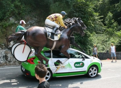One of the many strange promotional vehicles that proceed the riders