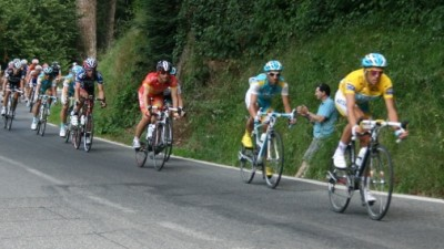 Contador in the yellow jersey with the pelaton behind