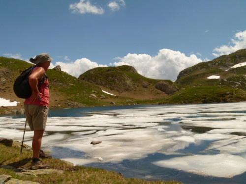 Richard looking over a still pretty iced up Lac Ayous - this was late July!