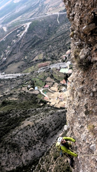 Climbing the last pitch, Riglos village in background