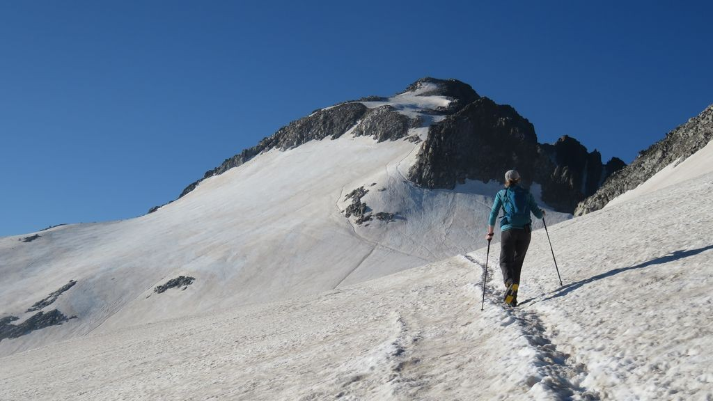 Crossing the Aneto Glacier with Aneto in the distance