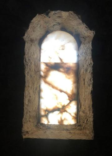 Alabaster window which are common in the Romanesque buildings of the area