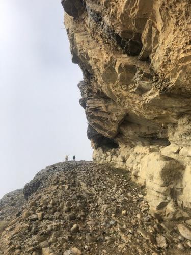 Ruby and Lucky near the top, where the path follows a rocky ledge.