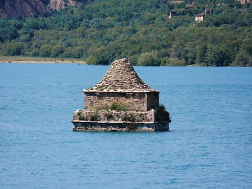 The semi-submerged church tower in the Embalse Mediano